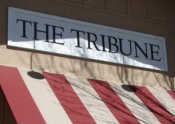 The Tribune may be under more red than just the awnings. -- Photo by Daniel Blackburn