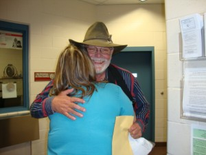 Dan De Vaul embraces juror number five as he leaves the jail