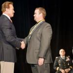 Gov. Arnold Schwarzenegger congratulates Brandon Akers