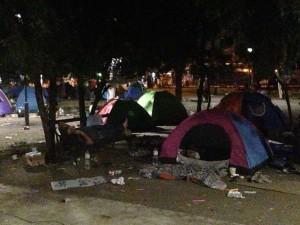 A baby sleeps inside a tent in Belgrade