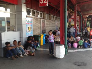 Refugees waiting for a bus at the Belgrade station