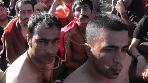 Iranians with their lips sewn shut