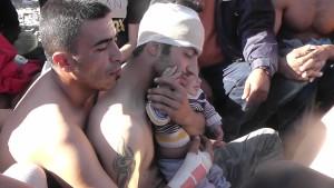 Iranian hunger strikers hug a toddler